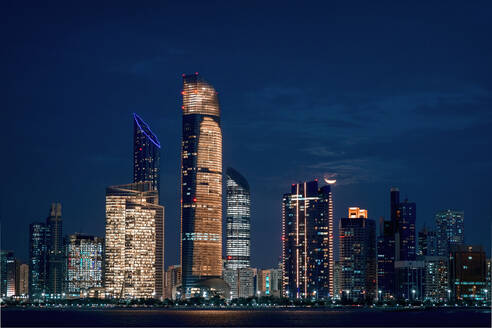 Illuminated Skyscrapers In City At Night - EYF07298