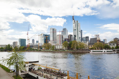 Germany, Frankfurt, Downtown skyscrapers seen across Main river - FLMF00258