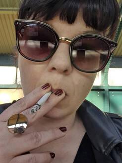 Smoking girl with sunglasses, Berlin, Germany - NGF00547