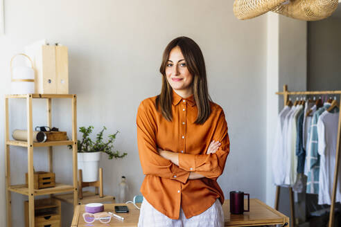 Portrait of a confident female fashion designer in home office - ERRF04053