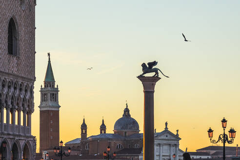 Columns of San Marco in San St Mark's Square at sunrise, in background San Giorgio Maggiore bell tower, telephoto, Venice, Italy. - MCVF00466