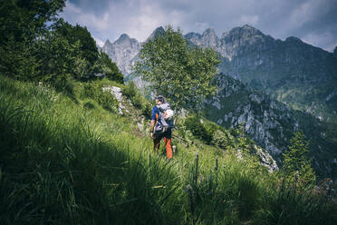 Hiker walking on mountain path, Orobie, European Alps, Como, Italy - MCVF00477