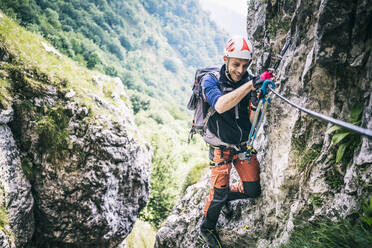 Mountaineer climbing on via ferrata, Orobie, European Alps, Como, Italy - MCVF00483