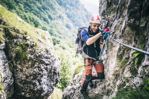 Mountaineer climbing on via ferrata, Orobie, European Alps, Como, Italy - MCVF00483