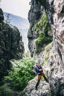 Mountaineer climbing on via ferrata, Orobie, European Alps, Como, Italy - MCVF00489