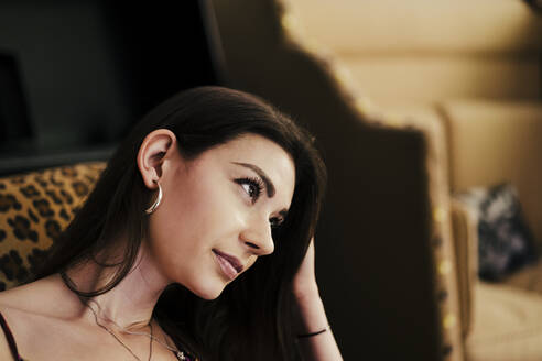 Close-up of beautiful woman looking away at home - EBBF00281