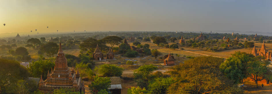 Myanmar, Mandalay Region, Bagan, Panorama of ancient Buddhist temples at dawn - TOVF00205