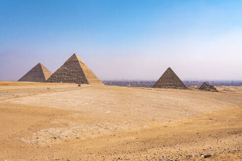 Egypt, Giza Governorate, Giza, Clear sky over Giza Pyramids - TAMF02471