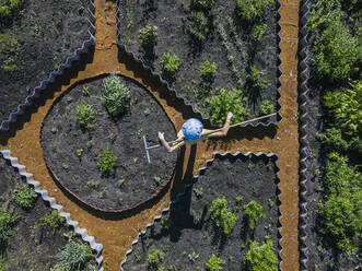 Aerial view of female worker at garden, Tikhvin, Russia - KNTF04744