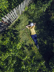 Aerial view of woman resting at garden, Tikhvin, Russia - KNTF04747