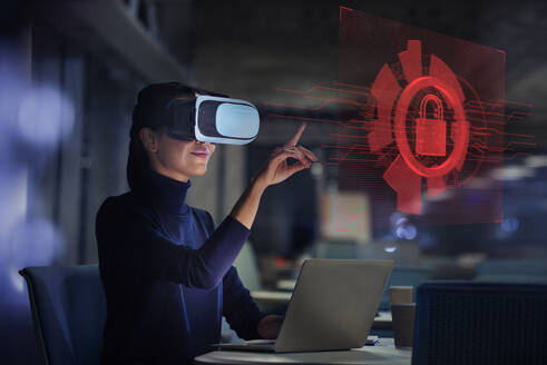 Businesswoman with virtual reality glasses looking at virtual screen - CAIF28204