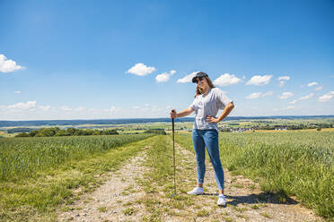Young woman playing golf at field - VTF00626