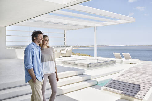 Couple at luxury beach house enjoying the view - RORF02250