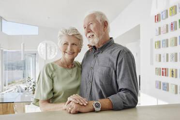 Smiling senior couple in a luxury villa - RORF02295