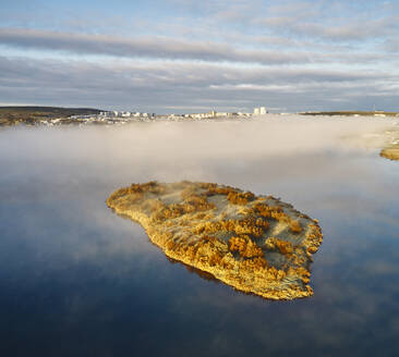 Island and lake in foggy evening time - CAVF86819