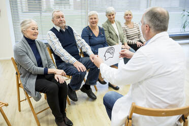 Group of seniors attending health counselling in retirement home - WESTF24588