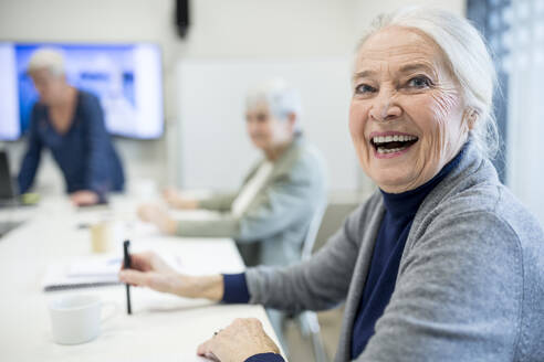 Happy senior woman attending seniors education course - WESTF24666