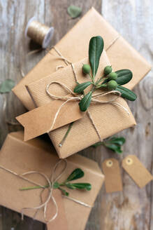 Homemade wrapped Presents on a wood table - ADSF00913