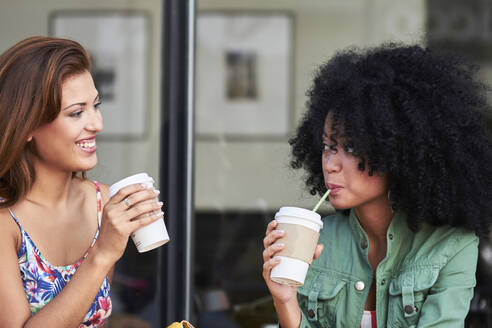 Girlfriends with coffee to go in cafe - PGCF00088