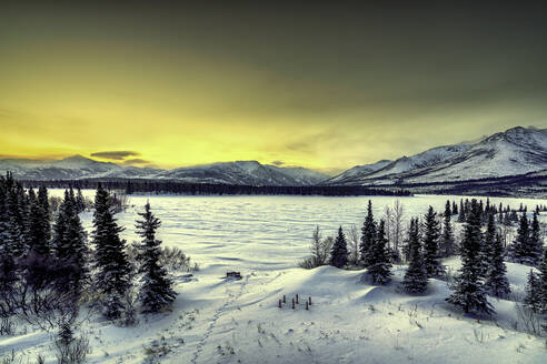 Sunrise over the frozen Otto Lake and snowy mountains of Denali National Park in the background, Alaska, United States of America, North America - RHPLF15816