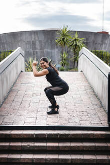Young woman during workout on bridge - JMPF00232