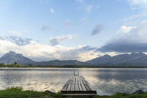 Idyllic view of jetty over lake against sky - DIGF12783