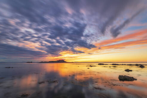 Tranquil view of Yellowcraigs Beach against cloudy sky, East Lothian, Scotland during sunset - SMAF01941