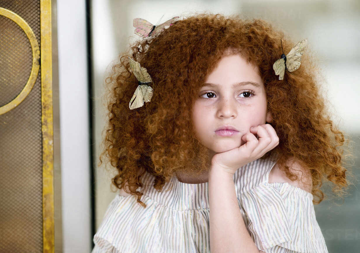 Portrait Serious Girl With Butterflies In Curly Red Hair Looking Away Fsif05121 Tamara Lackey Westend61