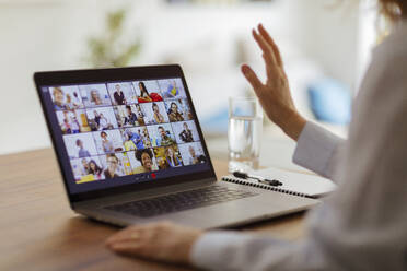 Friends video conferencing on laptop screen - CAIF28738