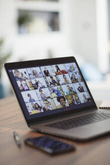 Colleagues video conferencing on laptop screen - CAIF28744