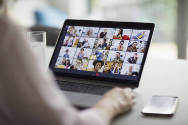 Colleagues video conferencing on laptop screen - CAIF28756