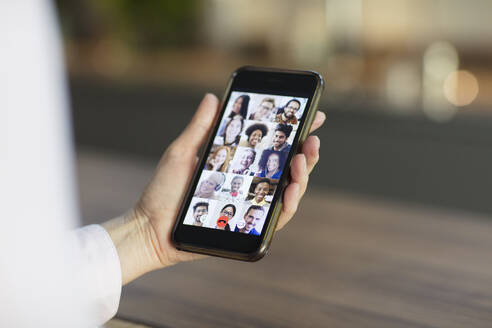 Friends video conferencing on smart phone screen - CAIF28765