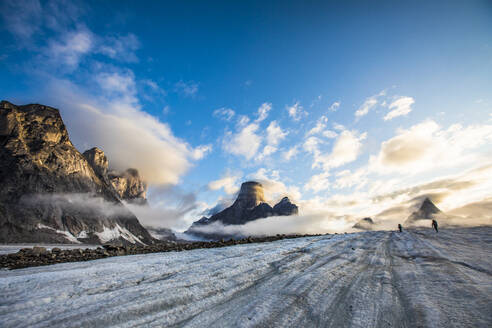Two hikers cross the Caribou Glacier, Baffin Island. - CAVF87640