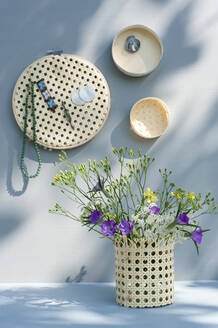 Wildflowers blooming in DIY vase made of embroidery frame - GISF00633