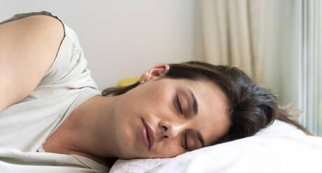 Woman sleeping in bedroom - AFVF06862