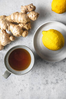 Studio shot of cup of tea, lemons and ginger root - FLMF00270