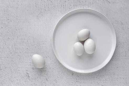White eggs on wooden table - ADSF07192