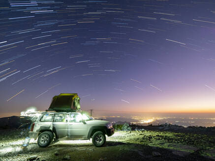 Star trails over truck camping site at Sharaf Al Alamayn, Sultanate of Oman, Middle East - RHPLF17033