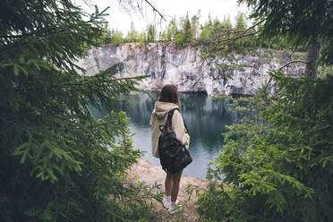 Young woman at Ruskeala mountain park, Sortavala, Republic of Karelia, Russia - KNTF05103
