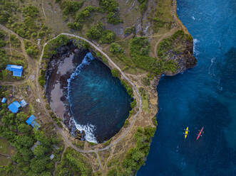 Two kayakers at Broken beach, Nusa Penida island, Bali,Indonesia - KNTF05112
