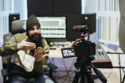 Dj making a video tutorial in his studio - XLGF00419