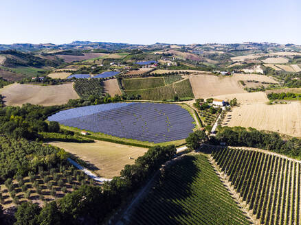 Italy, Marche, Aerial view of green countryside landscape in summer - GIOF08600