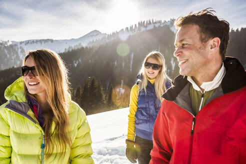 Portrait of smiling friends in winter landscape, Achenkirch, Austria - DHEF00286