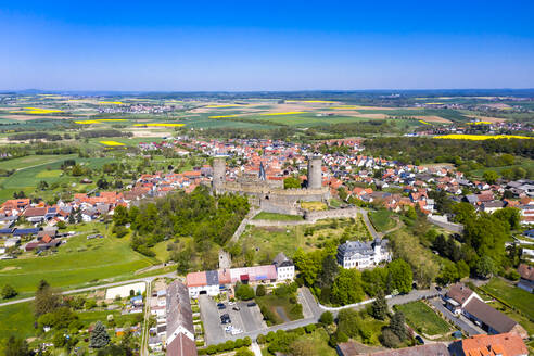 Germany, Hesse, Munzenberg, Helicopter view of Munzenberg Castle and surrounding village in summer - AMF08382