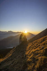 Hiker on viewpoint during sunset, Aggenstein, Bavaria, Germany - MALF00064