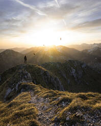 Female hiker standing on viewpoint during sunset, Saeuling, Bavaria, Germany - MALF00067