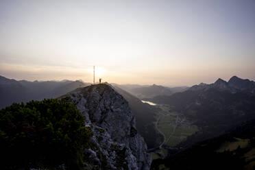 Hiker on viewpoint during sunset, Gaichtspitze, Tyrol, Austria - MALF00073
