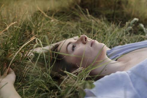 Beautiful woman relaxing on grass - DSIF00089