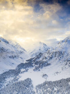 Aerial view of Lake Cavloc and woods covered with snow, Bregaglia Valley, Engadine, canton of Graubunden, Switzerland, Europe - RHPLF17419