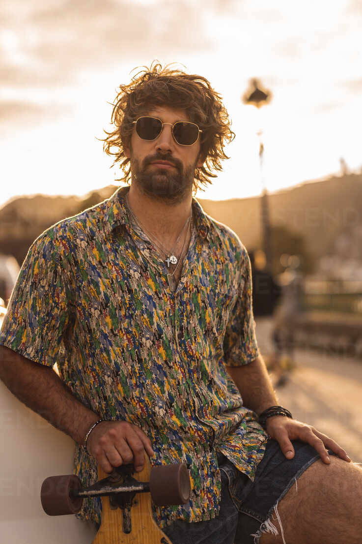 Hipster Guy With Sunglasses Wearing Shirt On A Summer Sunset Cavf88538 Cavan Images Westend61